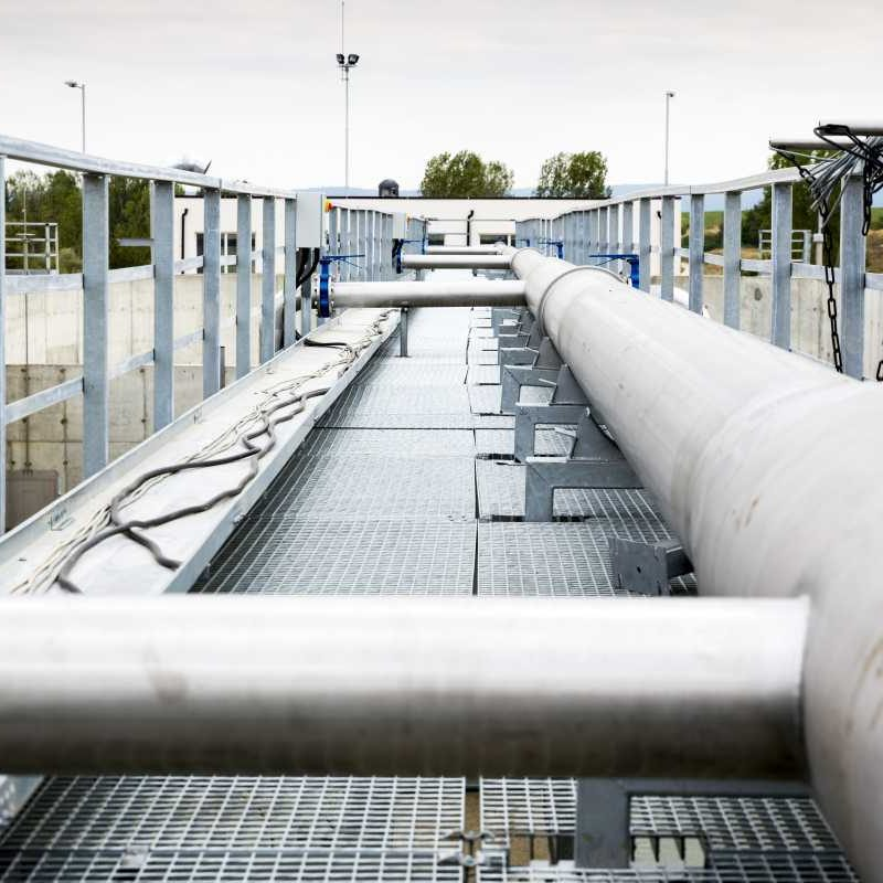 Wastewater treatment plant pipes. Water pumping station. Wastewater treatment is a process used to convert dirty wastewater into an effluent that can be either returned to the water cycle with minimal environmental issues or reused.